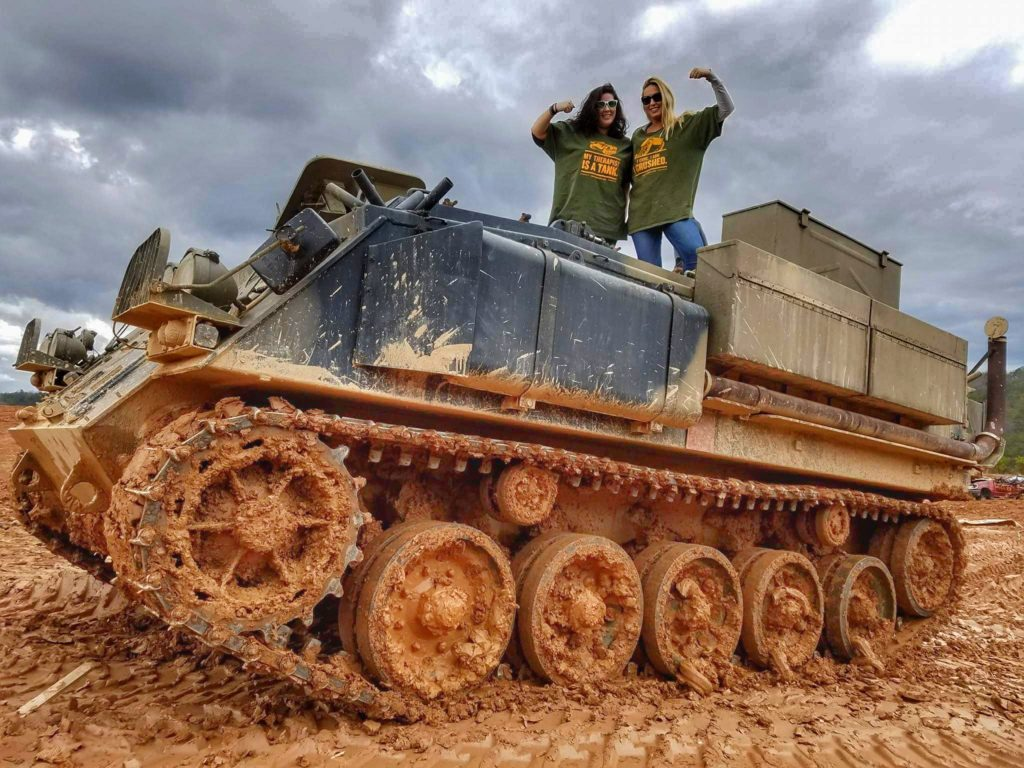 Girls driving tank