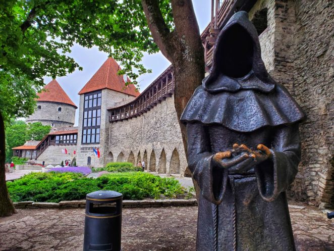 monk statue in talling old city on baltic itinerary